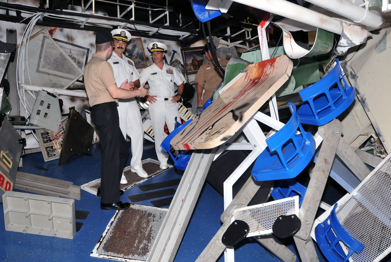 File:From left, U.S. Navy Gunner's Mate 1st Class Jordan Melancon, a  facilitator, escorts Rear Adm. Mark D. Guadagnini, deputy commander with  fleet ...