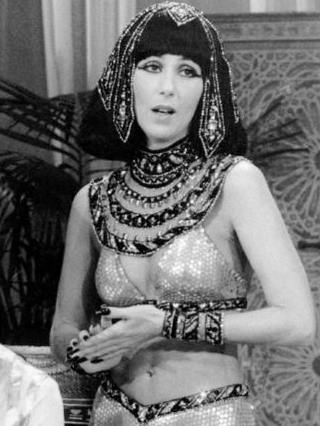 Cher exposing her navel for a scene from an Egyptian soap opera skit on The Sonny and Cher Show, 1977