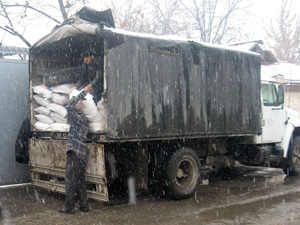 Supplies are unloaded from a truck in Tajikistan during the harsh 2007–2008 winter