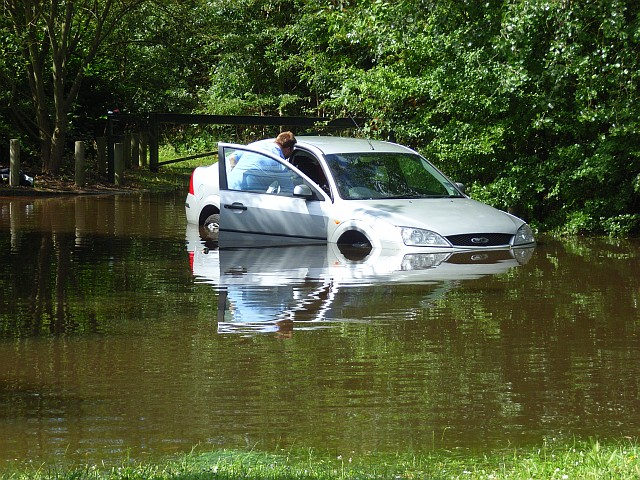 Car in flood water, Lower Earley - geograph.org.uk - 504343