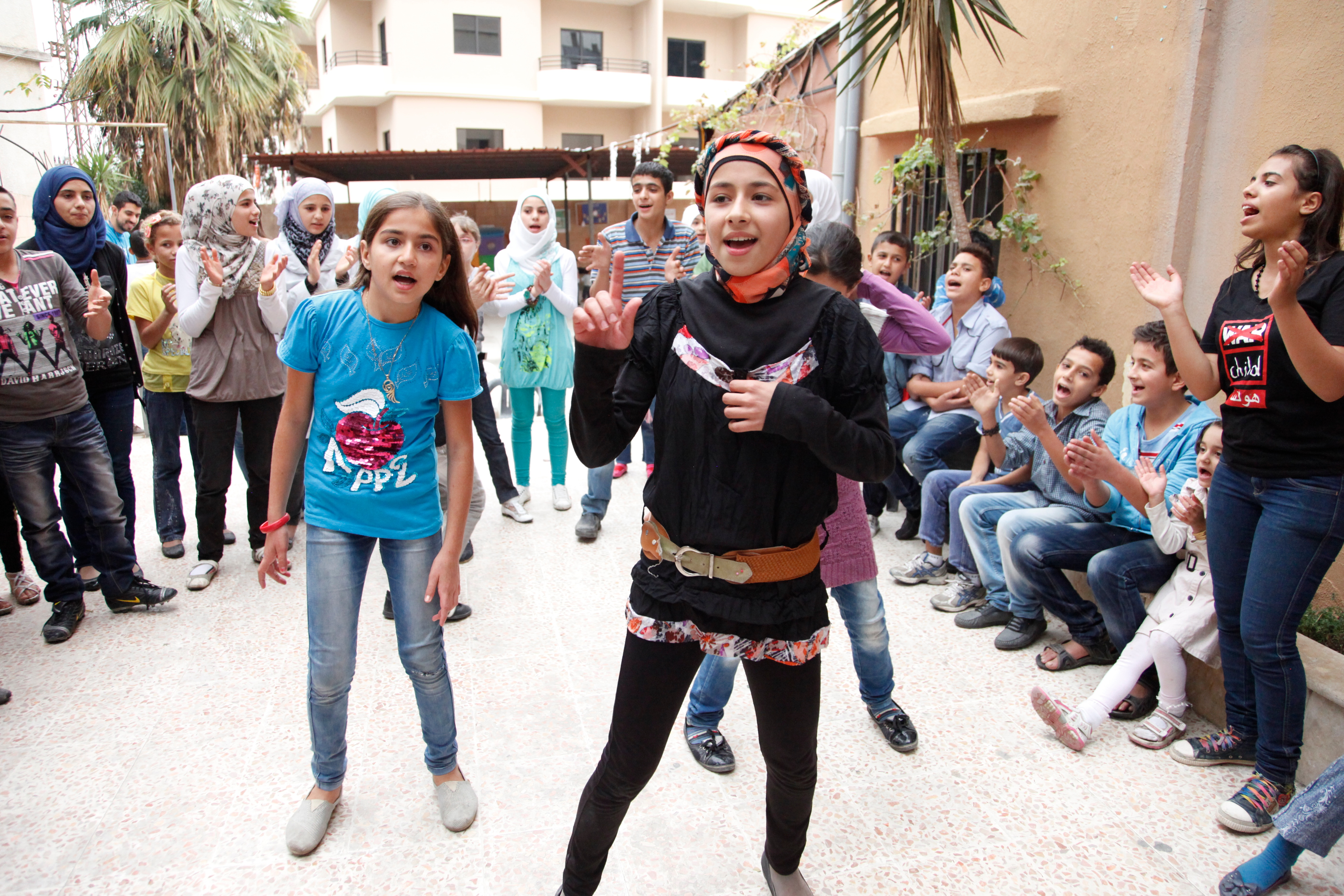 Adult Refugeis In Kid Schools