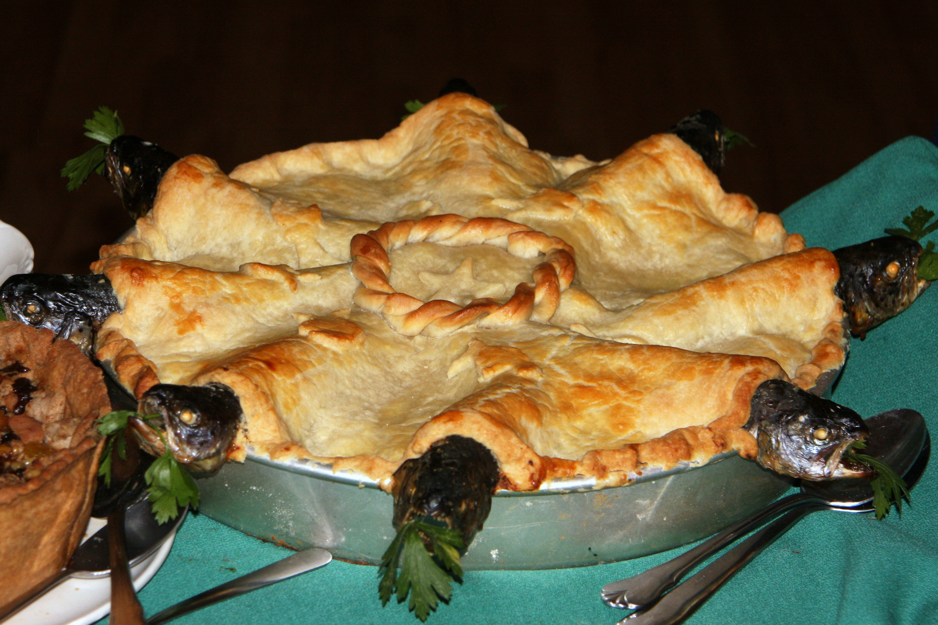 Behold the stargazy pie, a fish pie with sardines poking out of the piecrust, looking at the stars.