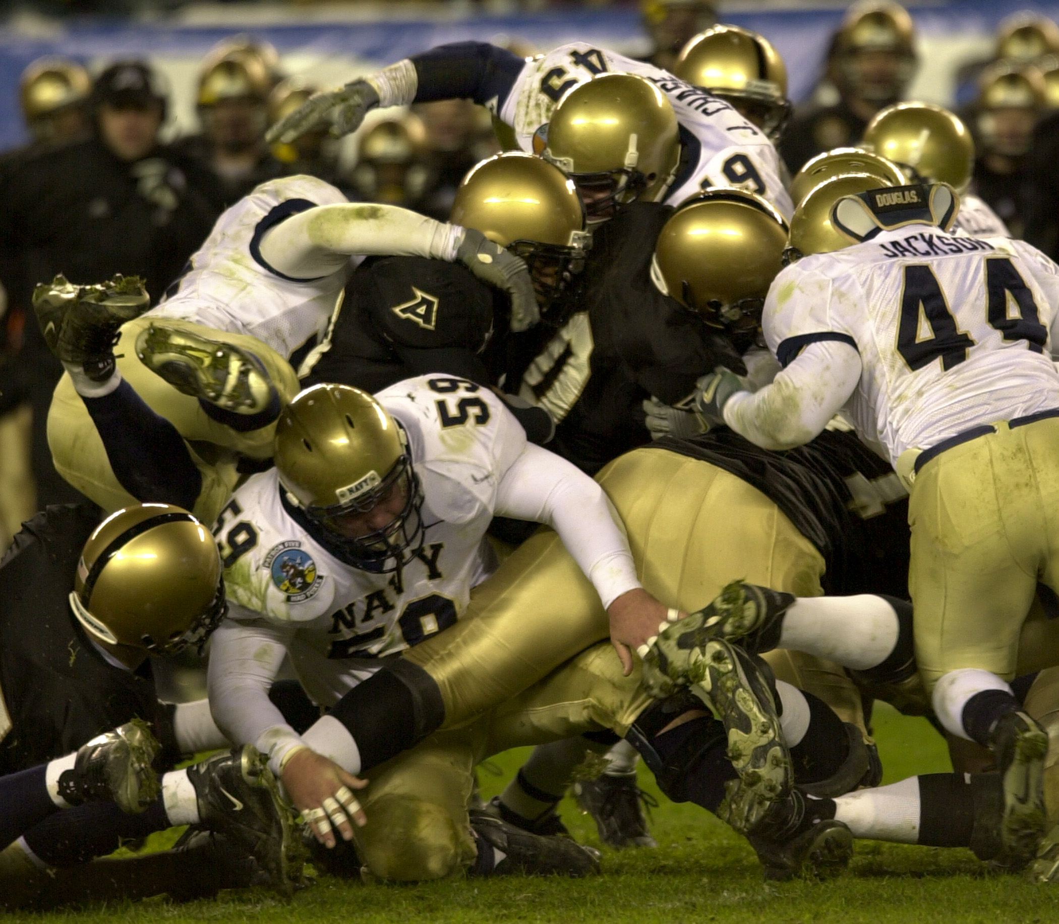http://upload.wikimedia.org/wikipedia/commons/2/23/US_Navy_031206-N-9693M-517_Army_and_Navy_football_players_vie_for_control_of_the_ball_during_the_104th_Army_Navy_Game.jpg