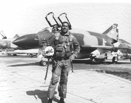Daniel James, Jr. in front of his McDonnell-Douglas F-4C Phantom