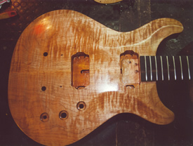 A guitar body, crafted from wood.