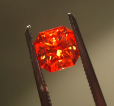 Faceted padparadscha Padparadscha sapphire.jpg