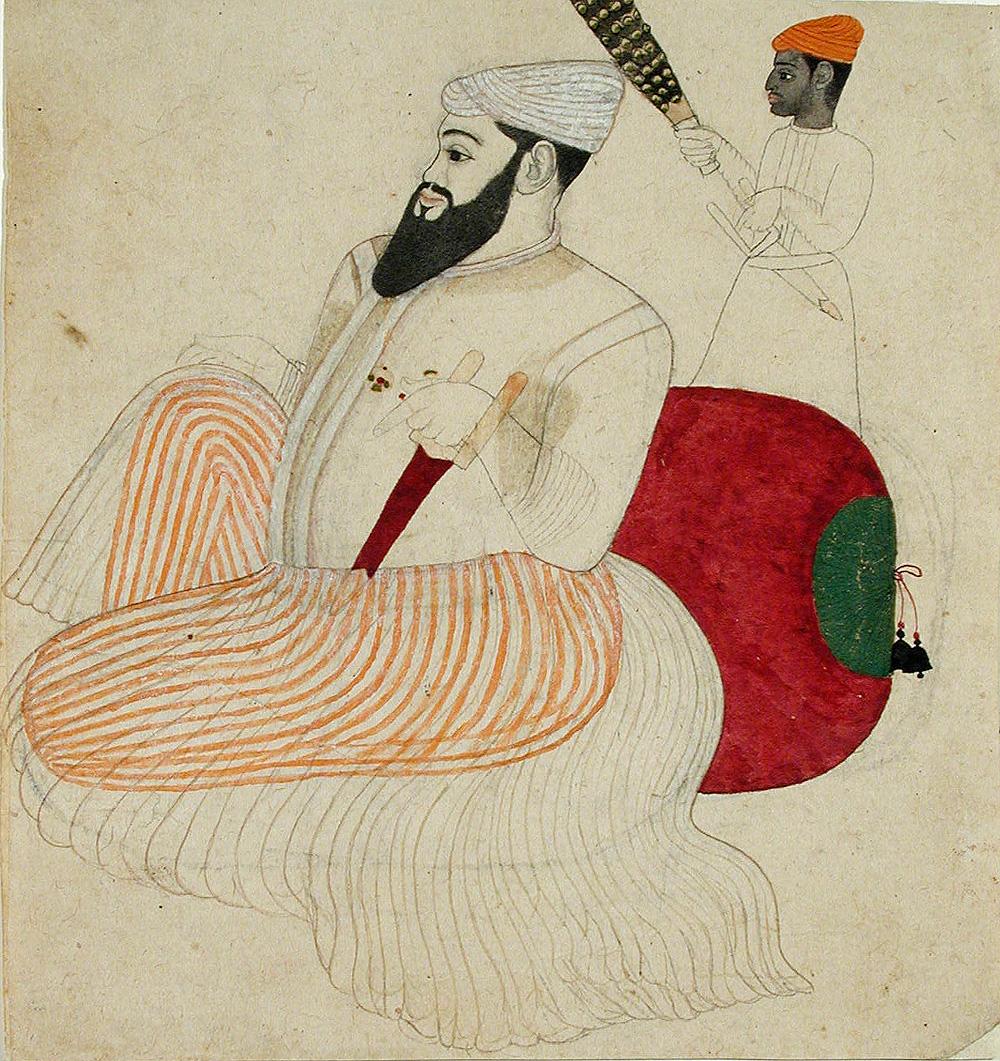 Man sitting on a bolster cushion
