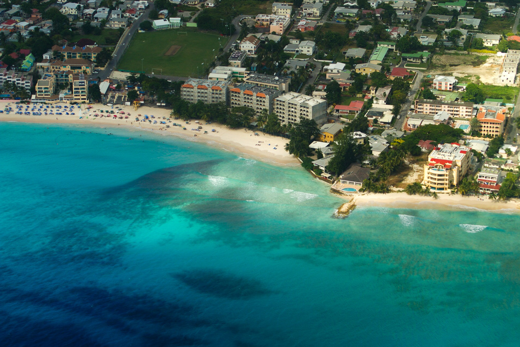 Aerial view of Dover beach in Barbados in the West Indies showing the blue waters, sandy shore and hotels and apartments inland