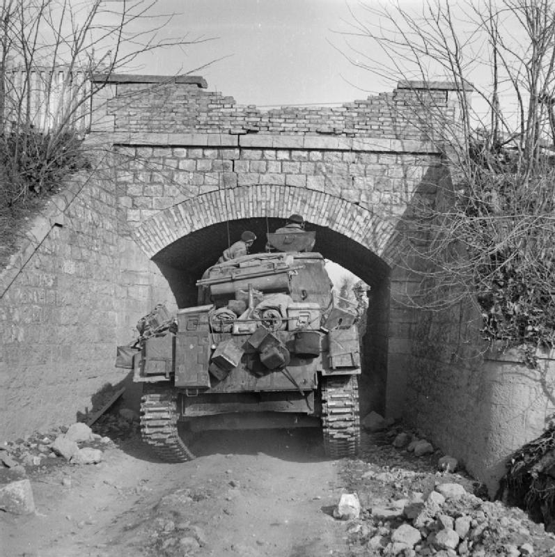A Sherman under a low bridge