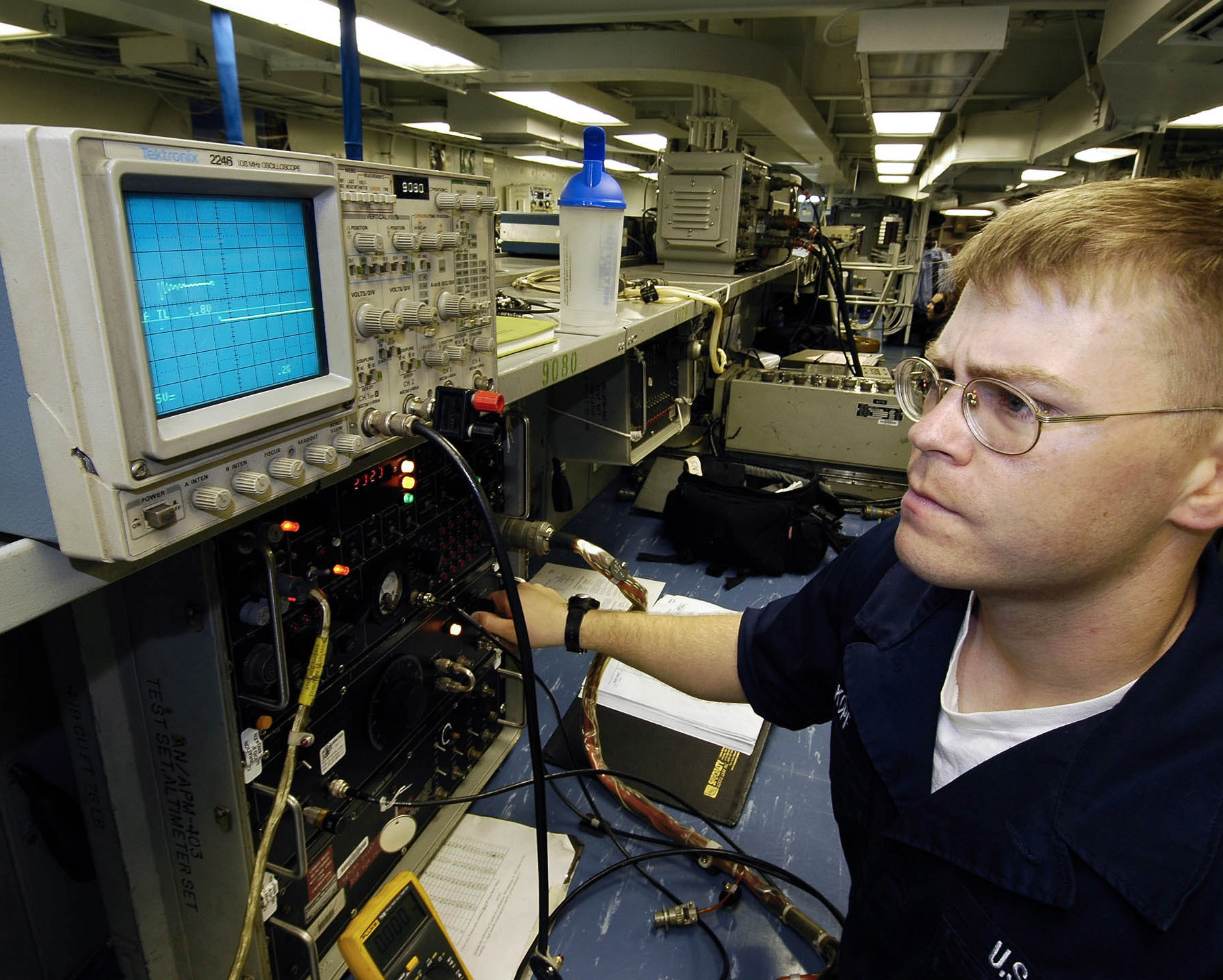 file us navy 060504 n 7981e 012 aviation electronics technician airman gary kopf uses an