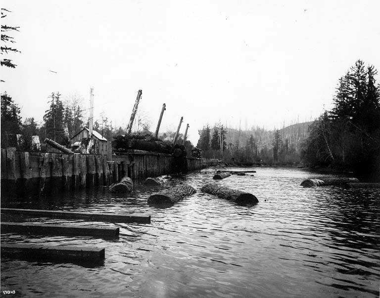 File:Dumping logs from railroad cars, A F Coats Logging Co