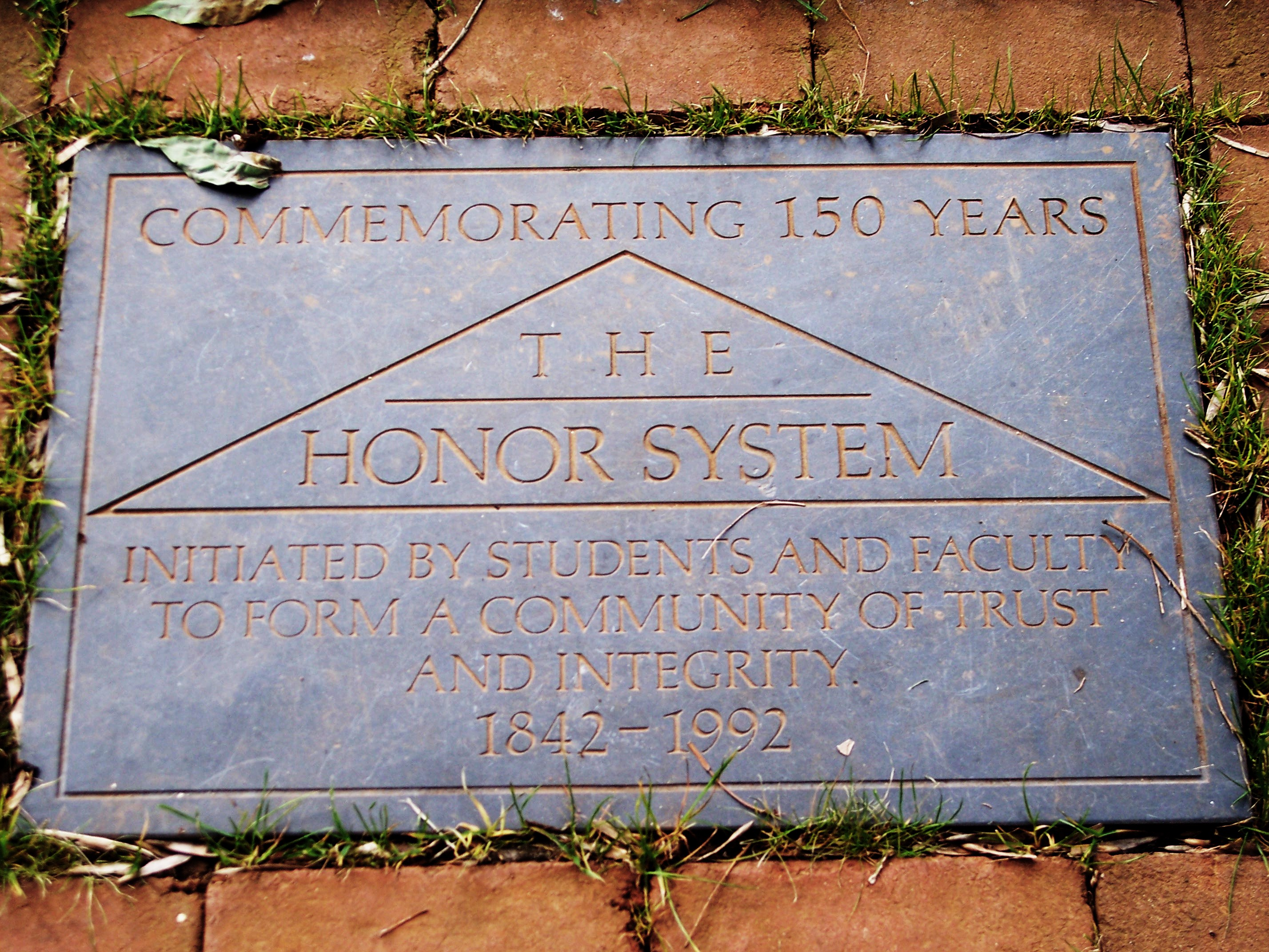 A plaque regarding 150 years of the Honor System, placed on the Lawn in 1992
