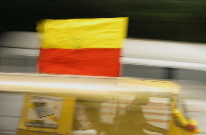 Un rickshaw portant les couleurs de l'Etat du Karnataka