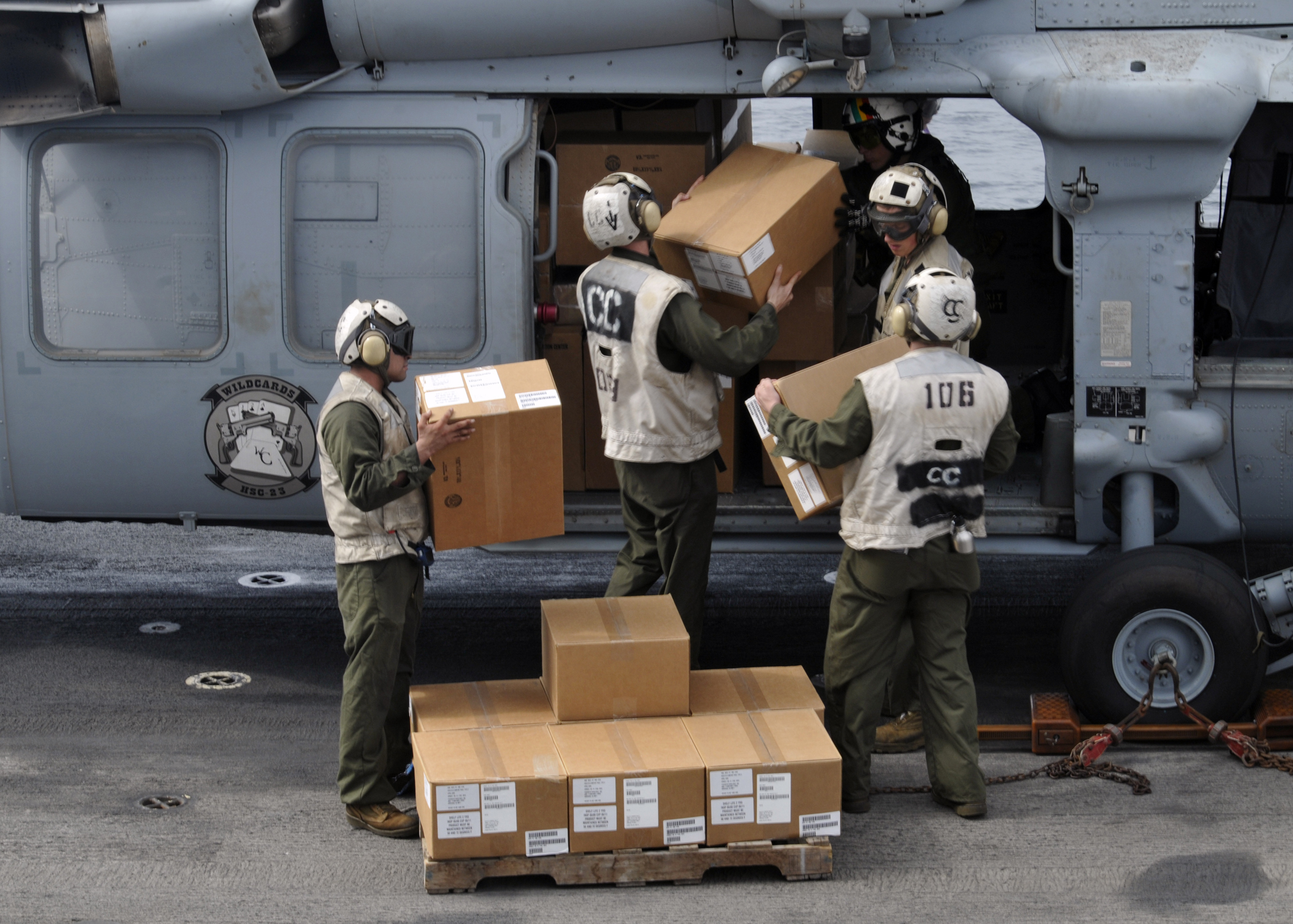 helicopter operations at sea with File Us Navy 100906 N 1485c 379 Marines Load Humanitarian Assistance Disaster Relief Supplies Onto An Mh 60s Sea Hawk Helicopter Aboard Uss Peleliu  Lha 5 on 1243 in addition Navy To Get Largestever Ship besides File US Navy 050726 N 0318R 021 Port Services and Helicopter Mine Countermeasures Squadron Fifteen  HM 15  personnel  load a MK 105 Mag ic Influence Minesweeping System  onto the  hibious assault ship USS Bataan  LHD 5 in addition Helicopter Sea  bat Squadron 26 also Scp169s eye found on rthalassophobia.