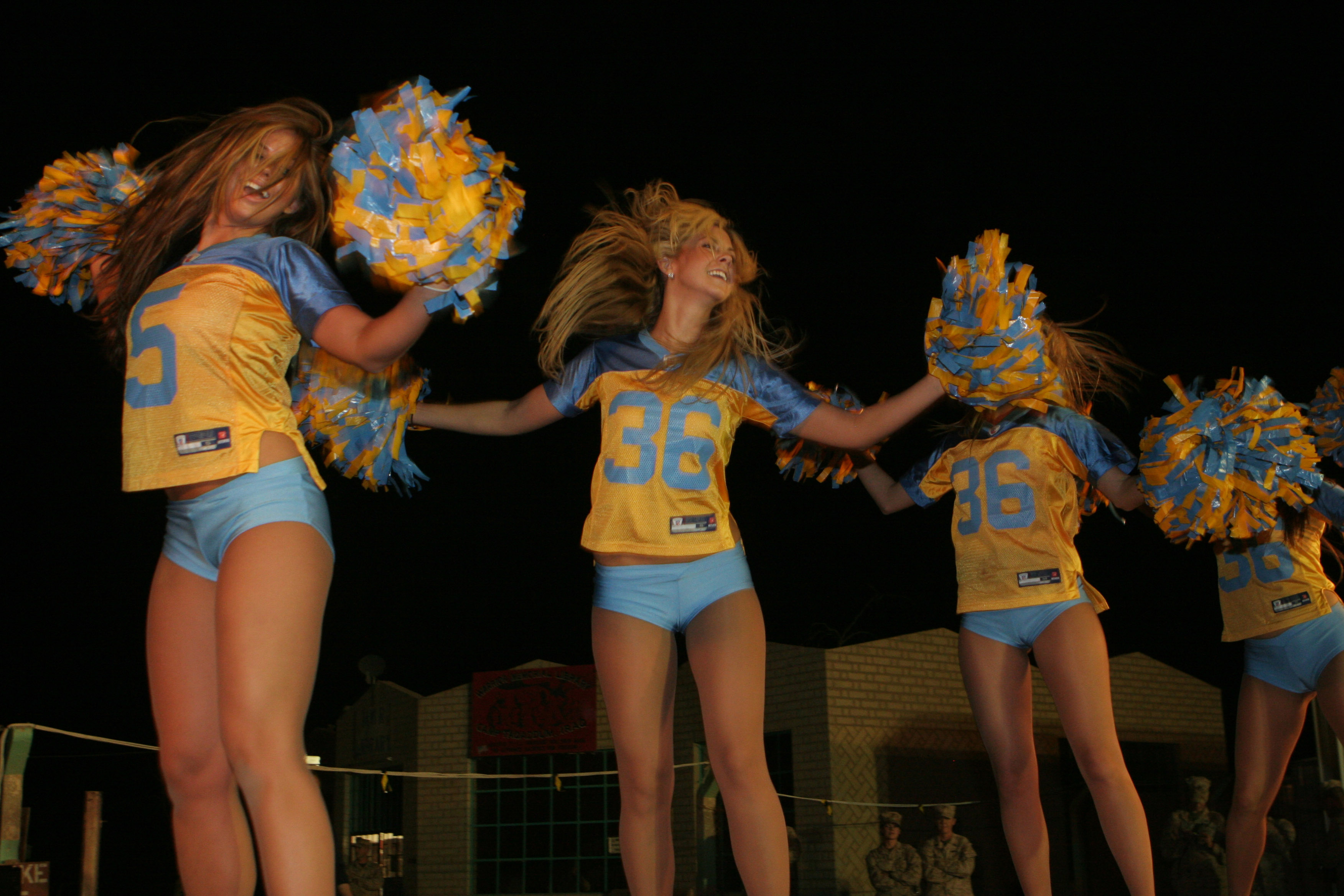 Description Eagles-Cheerleaders-Midair-turn-June-7-08.JPG