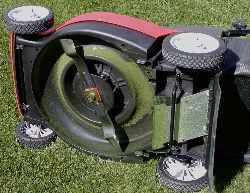 Photo of underside of electric lawn mover