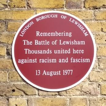 "Plaque memorialising the ""Battle of Lewisham"" in which anti-fascist protesters combatted a National Front march in 1977 Plaque for the Battle of Lewisham, New Cross Road and Clifton Rise (cropped).jpg"