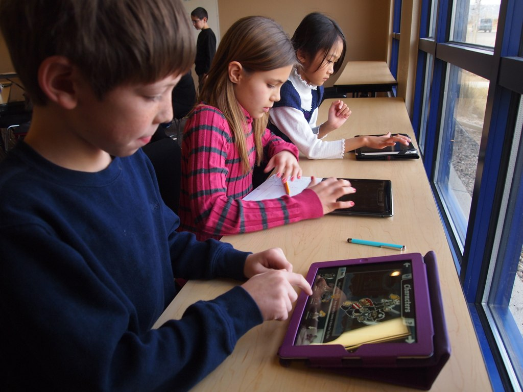 Schoolchildren with iPads