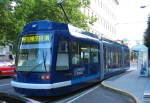 A streetcar at the corner of SW 11th and Alder.