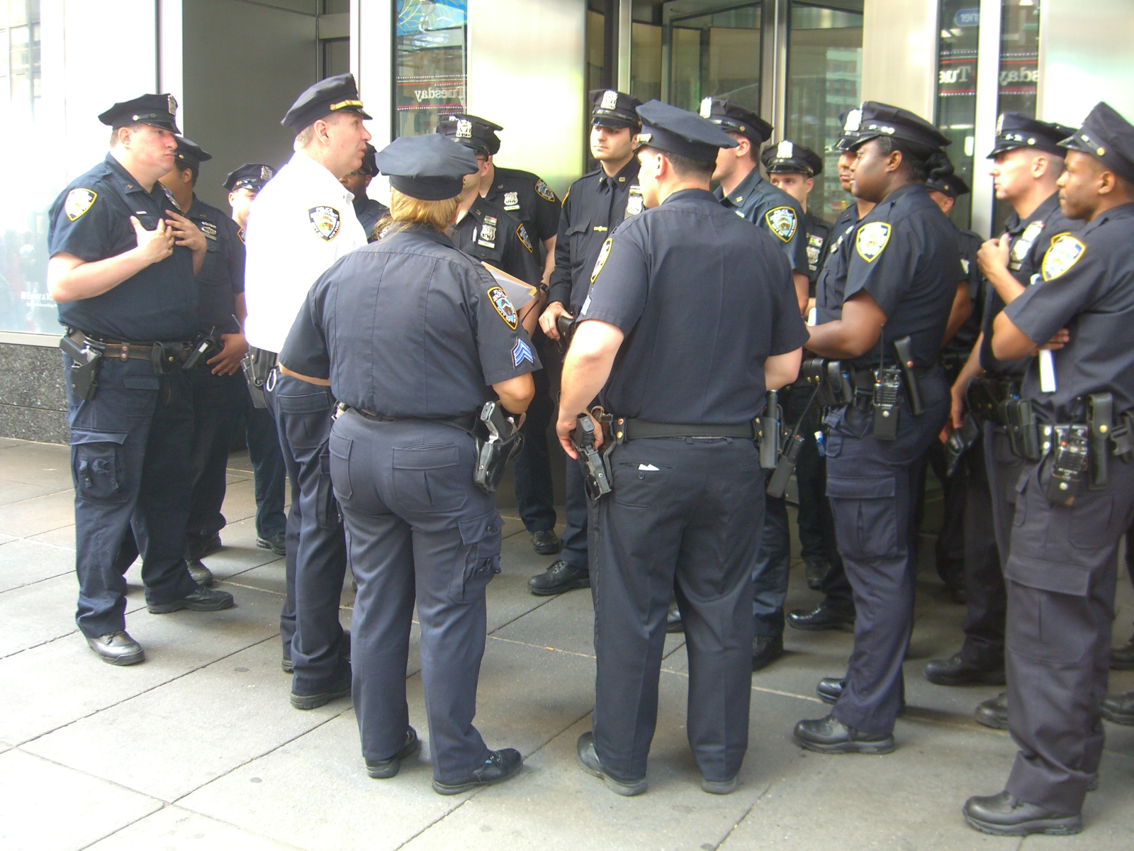New York City Police officers being debriefed by their lieutenant (in the white shirt) in Times Square, May 29, 2010.