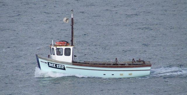 FileA Small Fishing Boat Approaching Its Home Port