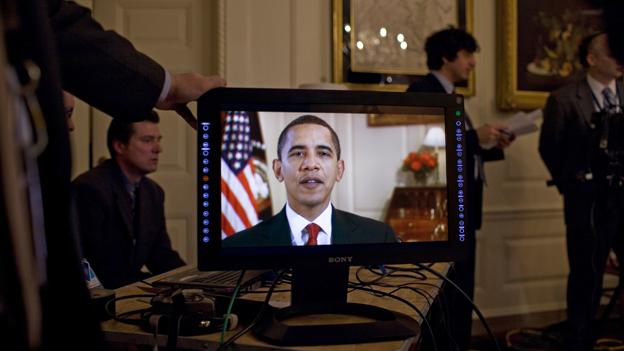 President Obama on a video screen