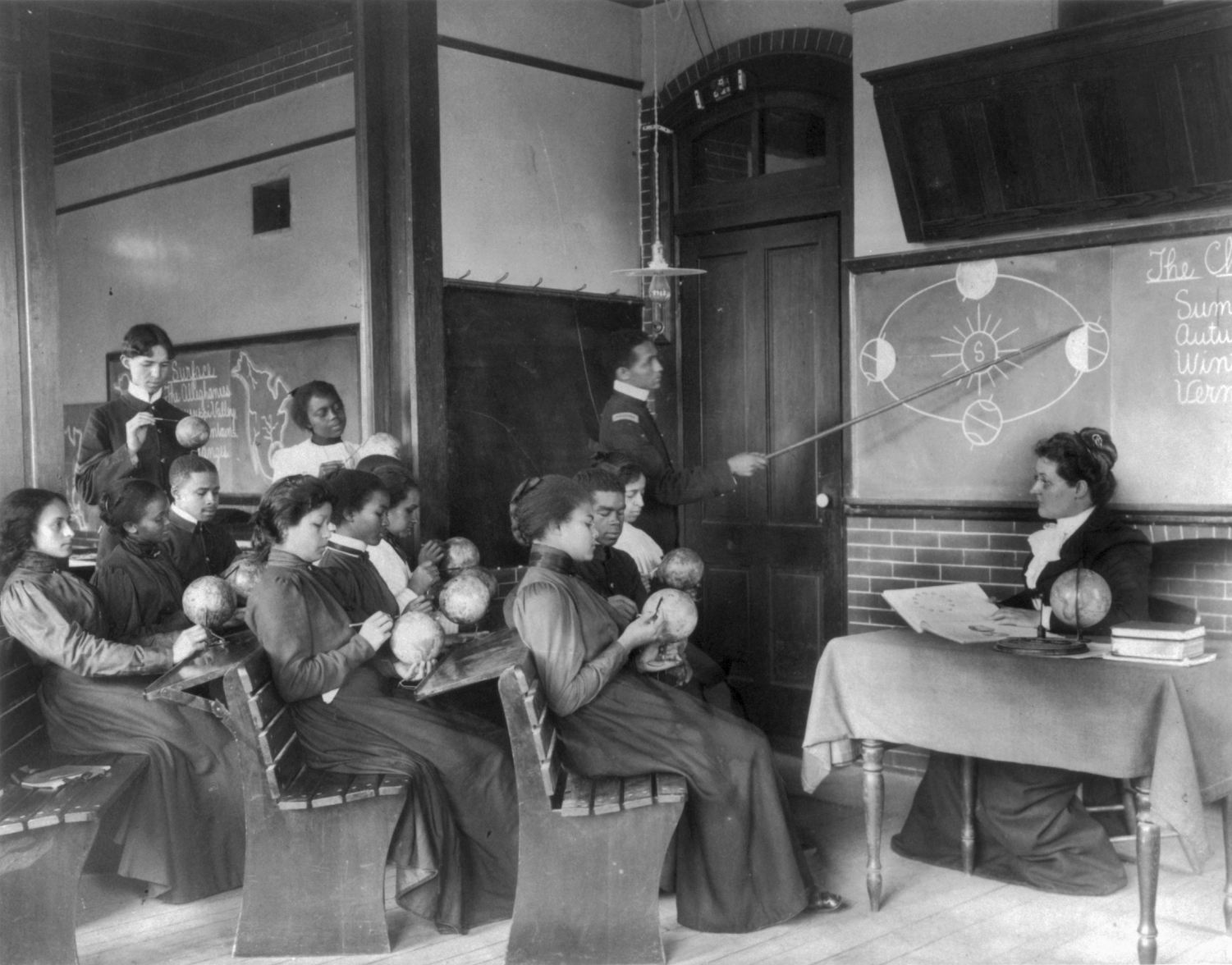 A class in mathematical geography studying earth's rotation around the sun, Hampton Institute, Hampton, Virginia, ca 1899. I love that students have their hands on more than maps. Image courtesy Frances Benjamin Johnston Collection via Wikimedia Commons.