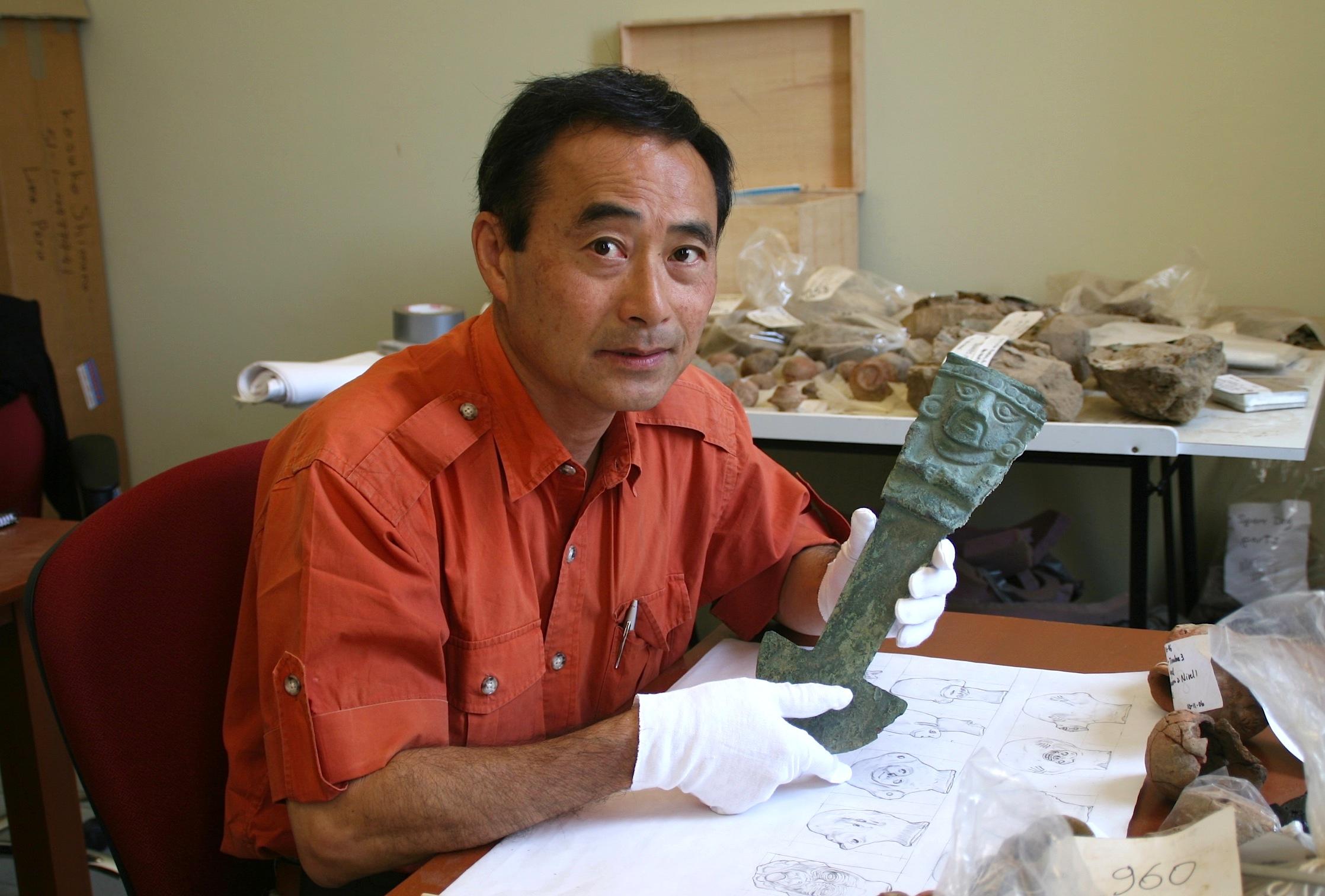 Professor Izumi Shimada holding tumi knife excavated at Huaca Loro in 2006
