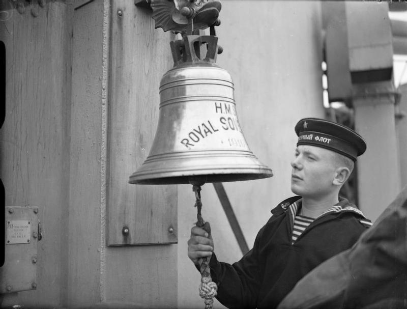 A Russian sailor ringing the ship's bell