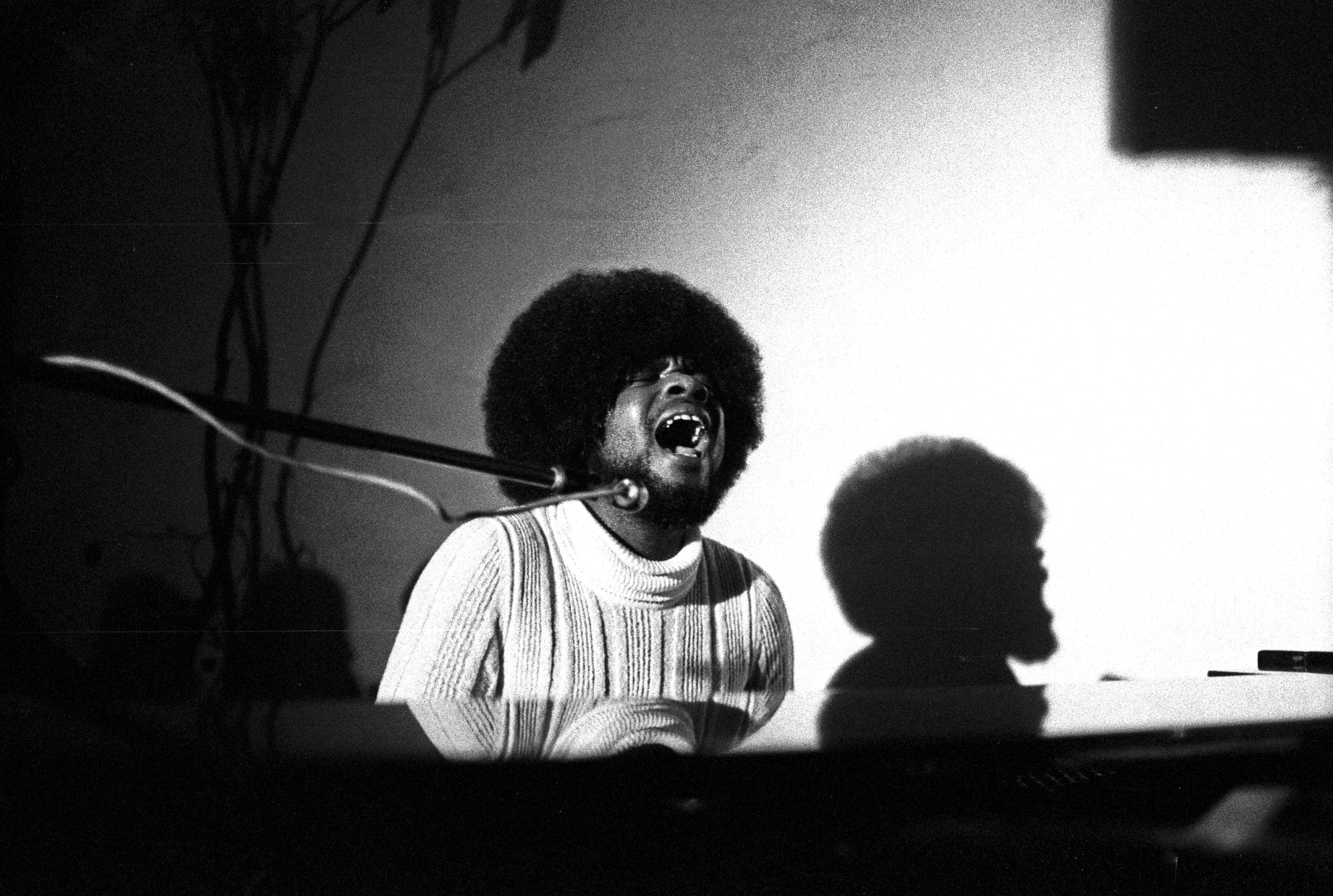 Photo of billy Preston singing and playing piano