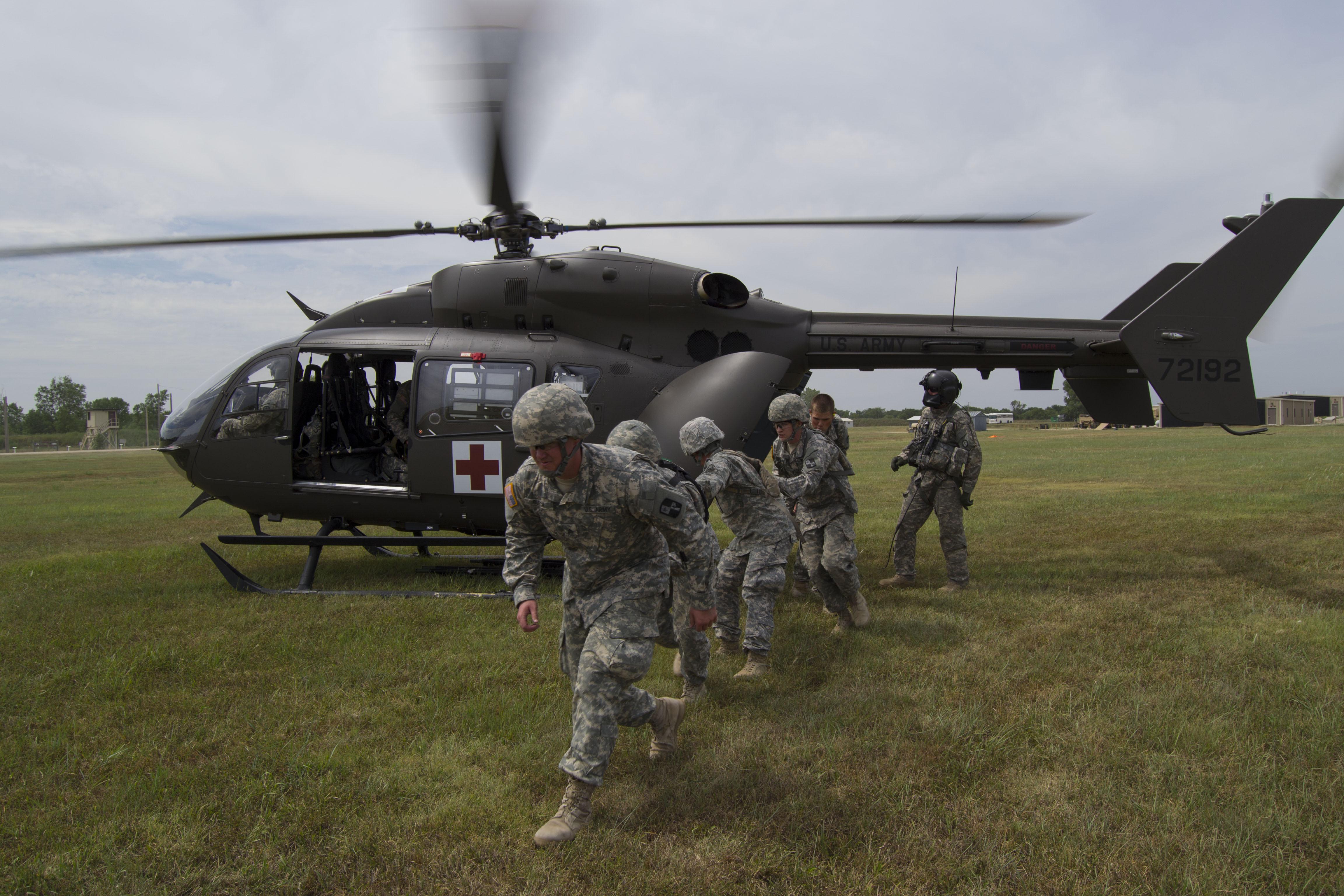 file civilian  military medical evacuation teams save