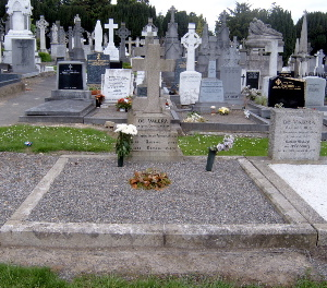 Eamon de Valera's grave. His wife, Sinead, and son, Brian (who was killed in a horse-riding accident in 1936) are buried there also. (Close up view of the gravestone) Devgrave.jpg