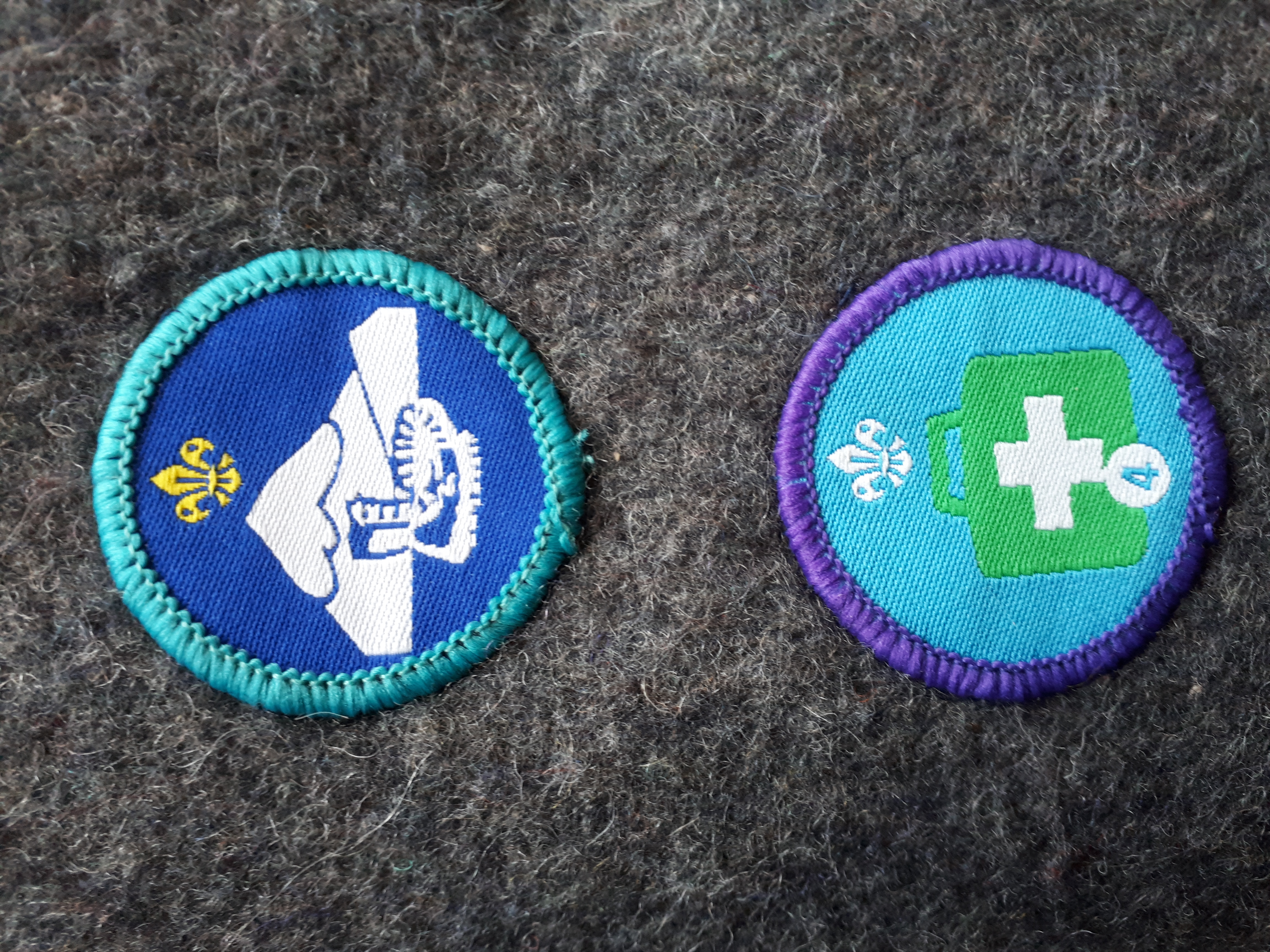 Badge the meaning of scout Symbols of