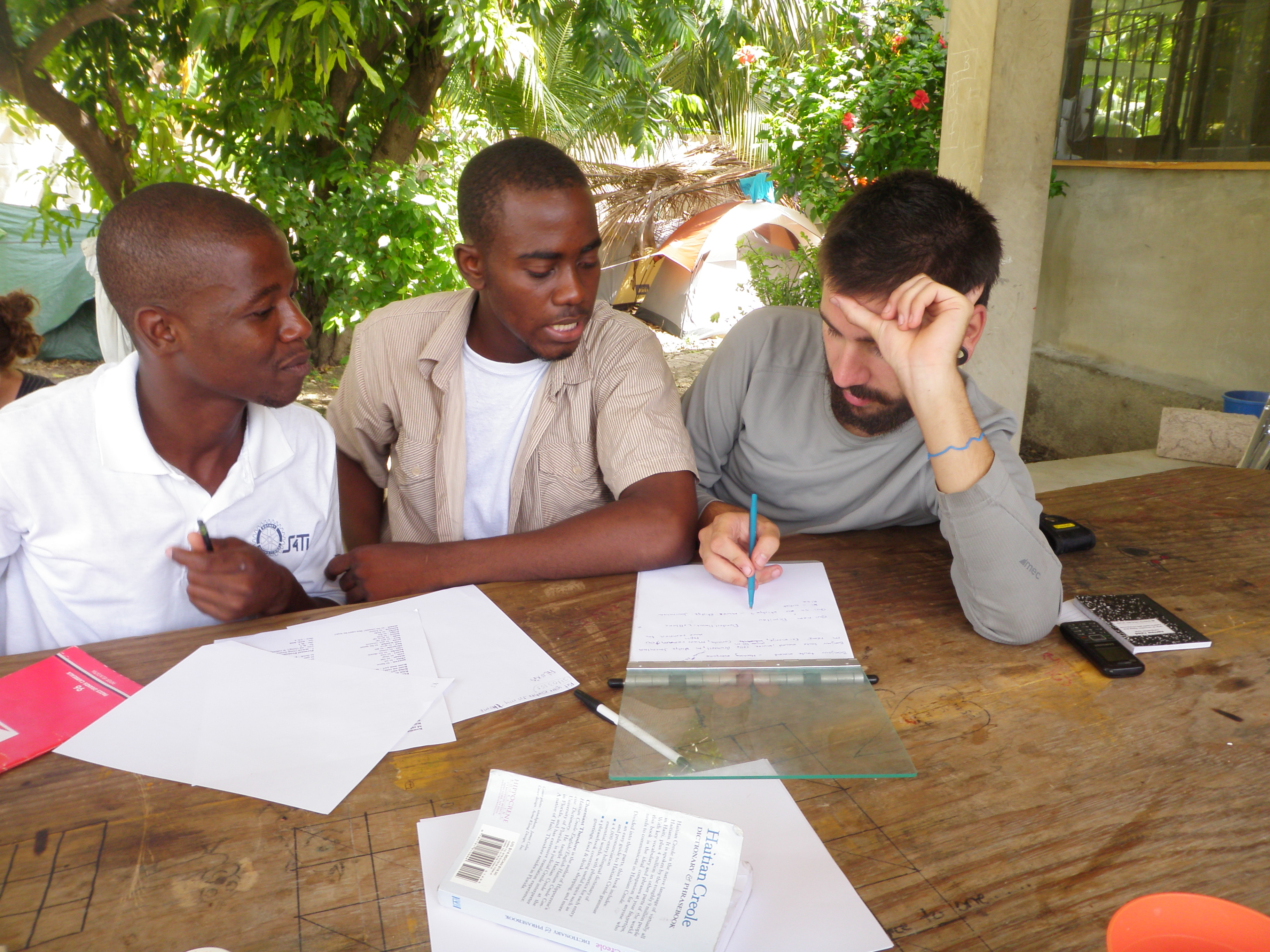 File:Haitian students learn English from Canadian volunteer jpg