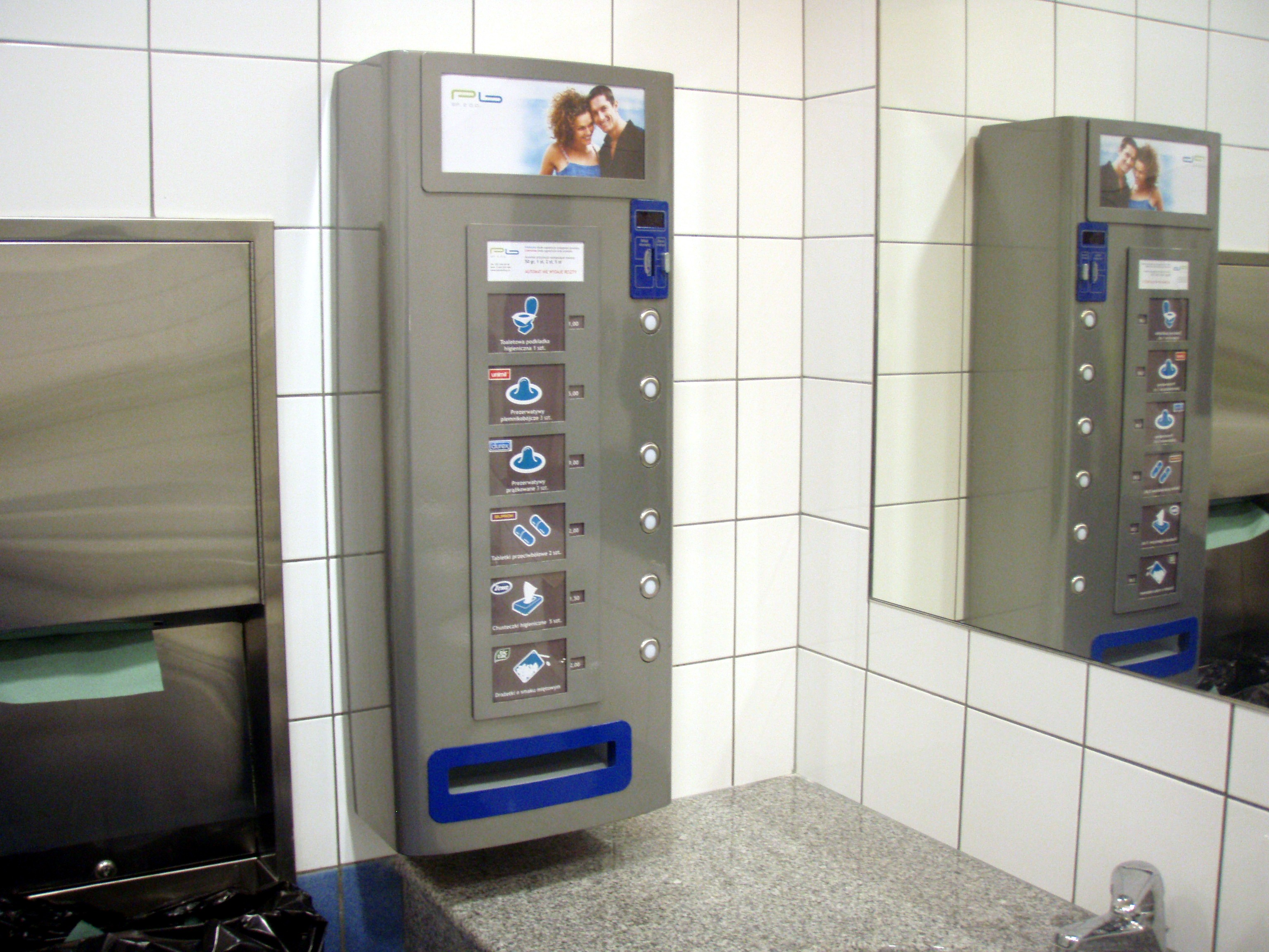 A vending machine in a restroom with hygiene products, in Katowice, Poland