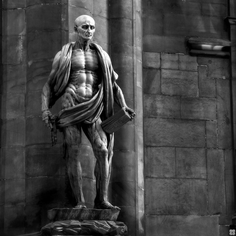 St. Bartholomew, his skin flayed and draped around his body, a knife in one hand and the Good Book in the other