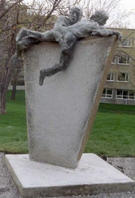 "The annual obstacle course race at Royal Military College of Canada is memorialized by a sculpture by John Boxtel, ""To Overcome"", which was a gift from the 1991 graduating class"