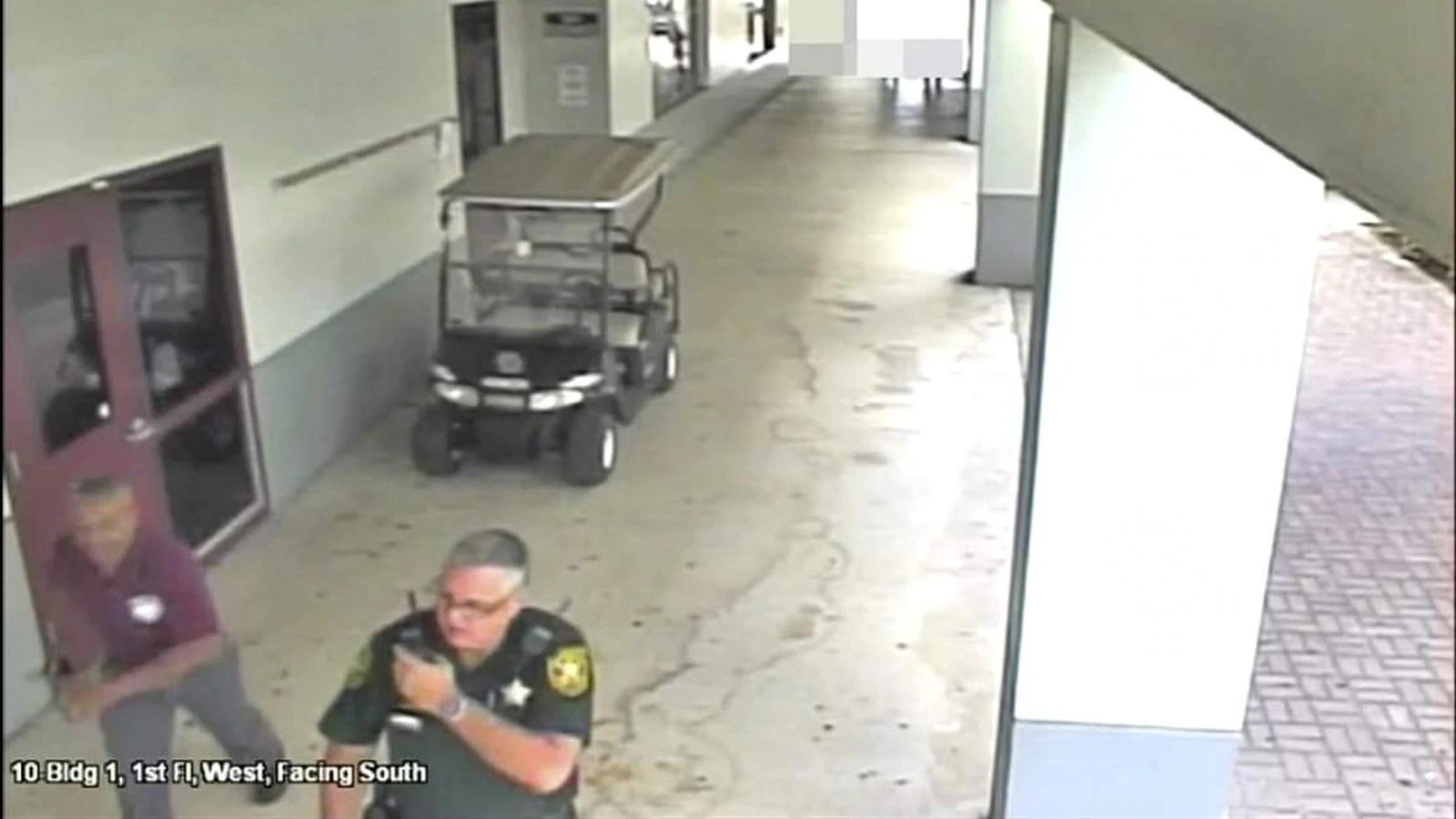 BCSO deputy Scot Peterson outside as gunman murders students inside Marjory Stoneman Douglas High School