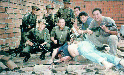 Members of Colonel Martinez's Search Bloc celebrate over Pablo Escobar's body on December 2, 1993. Pablo's death ended a fifteen-month effort that cost hundreds of millions of dollars.