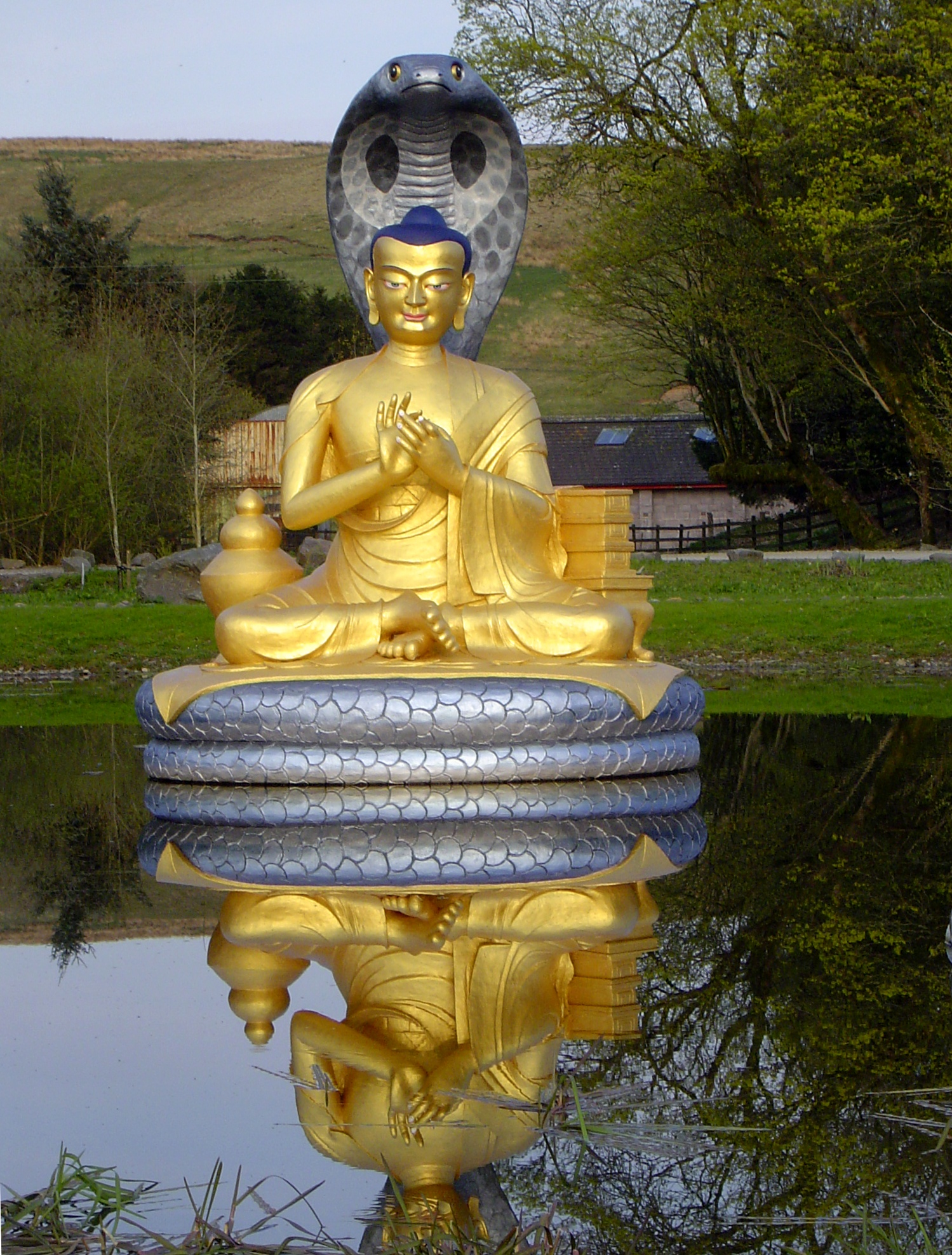 Golden statue of Nāgārjuna at [[Kagyu Samye Ling Monastery and Tibetan Centre|Kagyu Samye Ling Monastery]], [[Scotland]].