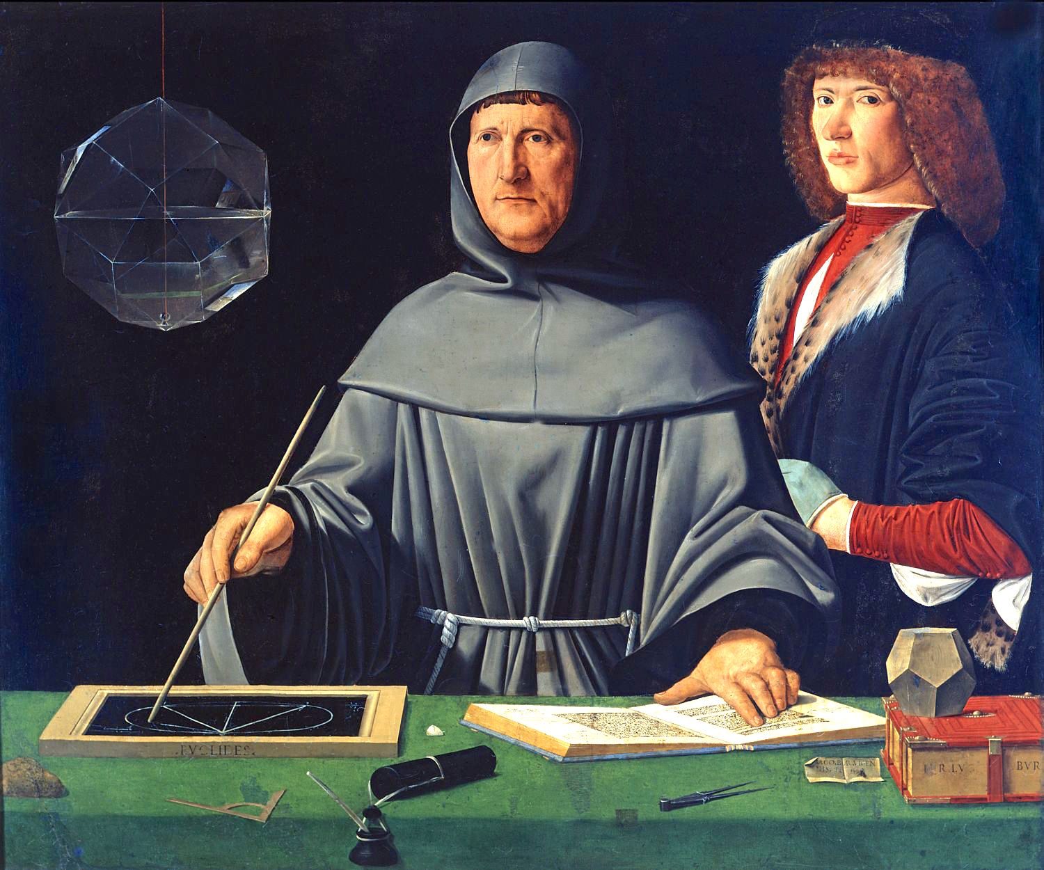 A painting of two men. The man at the center is looking off to his right while drawing a symbol with his right hand. His left hand is resting on a page in a book. He is wearing a robe with a hood. The man on the right is looking towards the front and is wearing a long-sleeve red shirt with a black jacket. Several writing utensils and books are on a table with a green tablecloth in the front of the image.