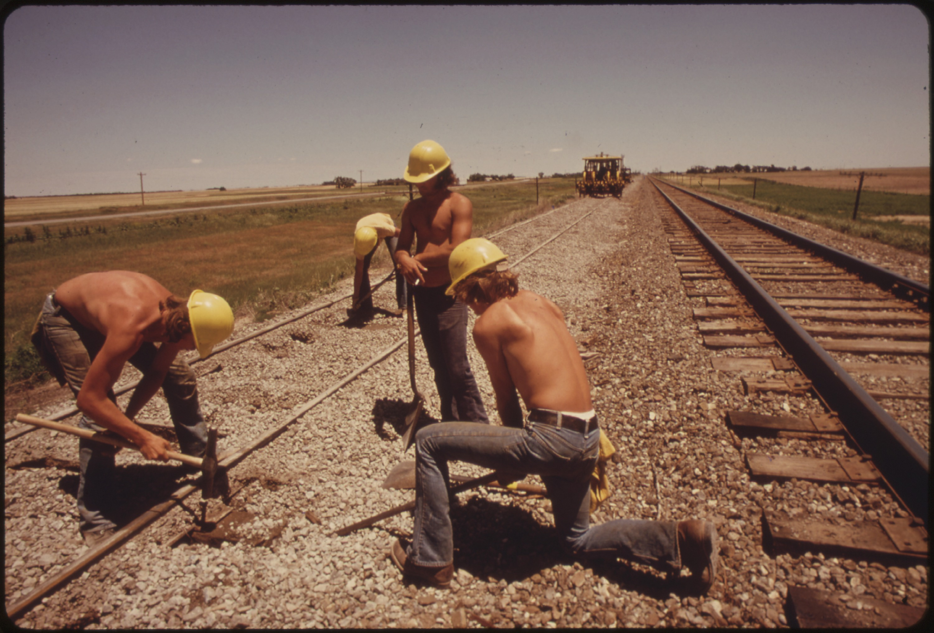 File:RAILROAD WORK CREW IMPROVES THE TRACKS AND BED OF THE