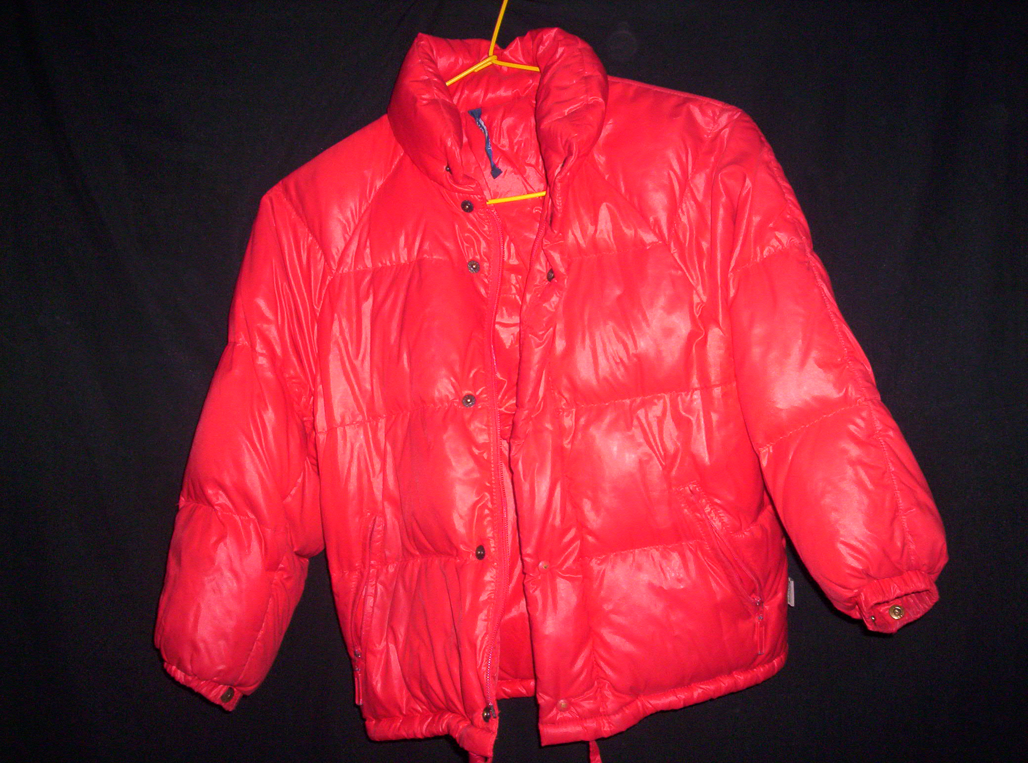 A red quilted ski jacket