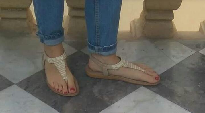 Feet of girl in flip flops sandals.jpg