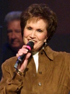 Jan Singing on the Opry in Brown Jacket (cropped) (3).jpg
