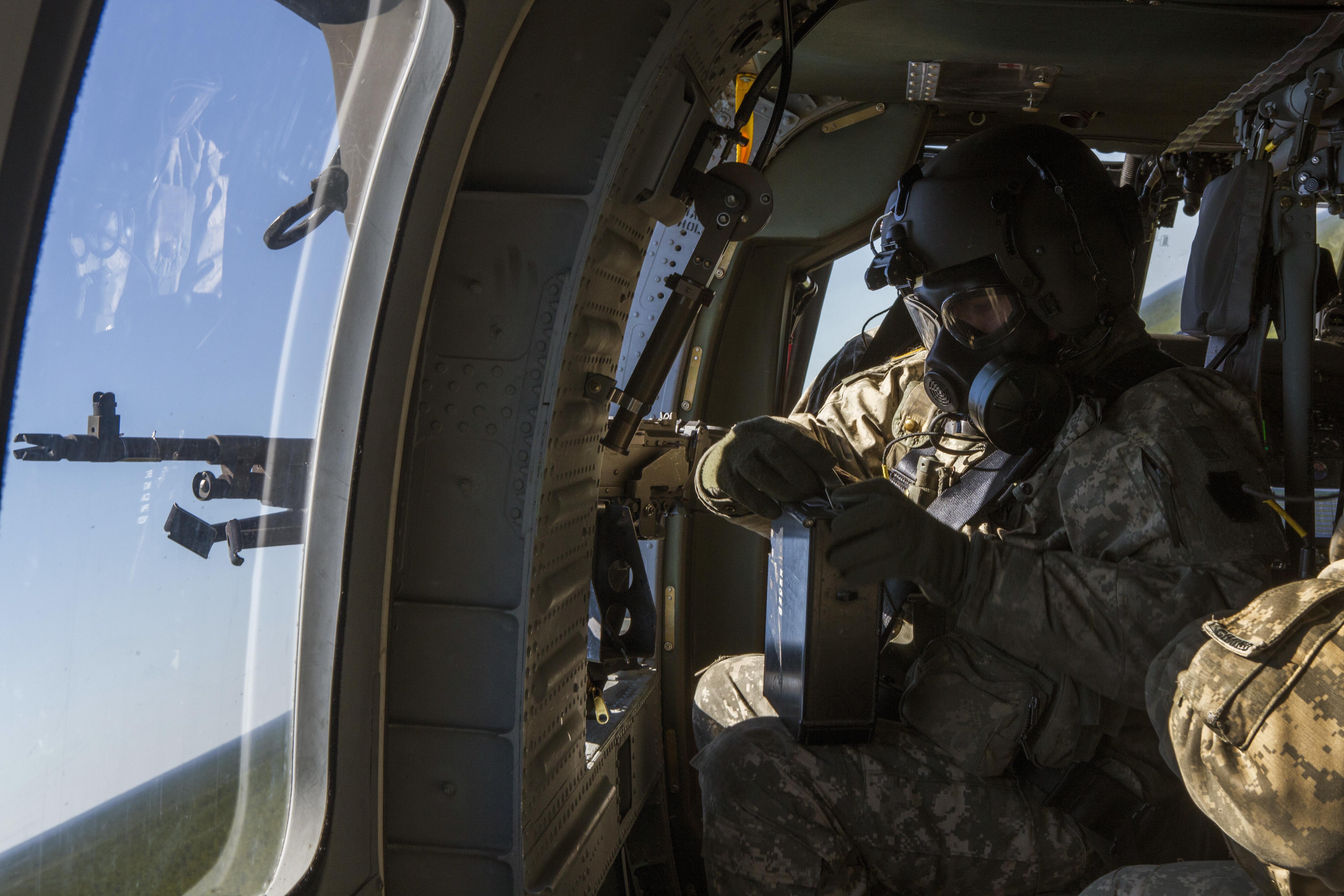 file nj army guard aviators qualify on aerial door gunnery 160415 z rh commons wikimedia org Army Vehicle Gunnery Army Gunnery Training