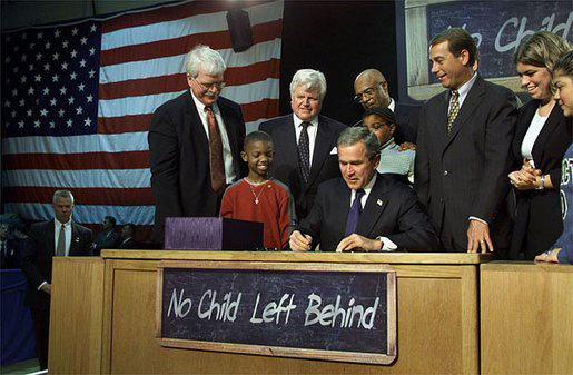 The signing of the No Child Left Behind Act via Wikimedia Commons