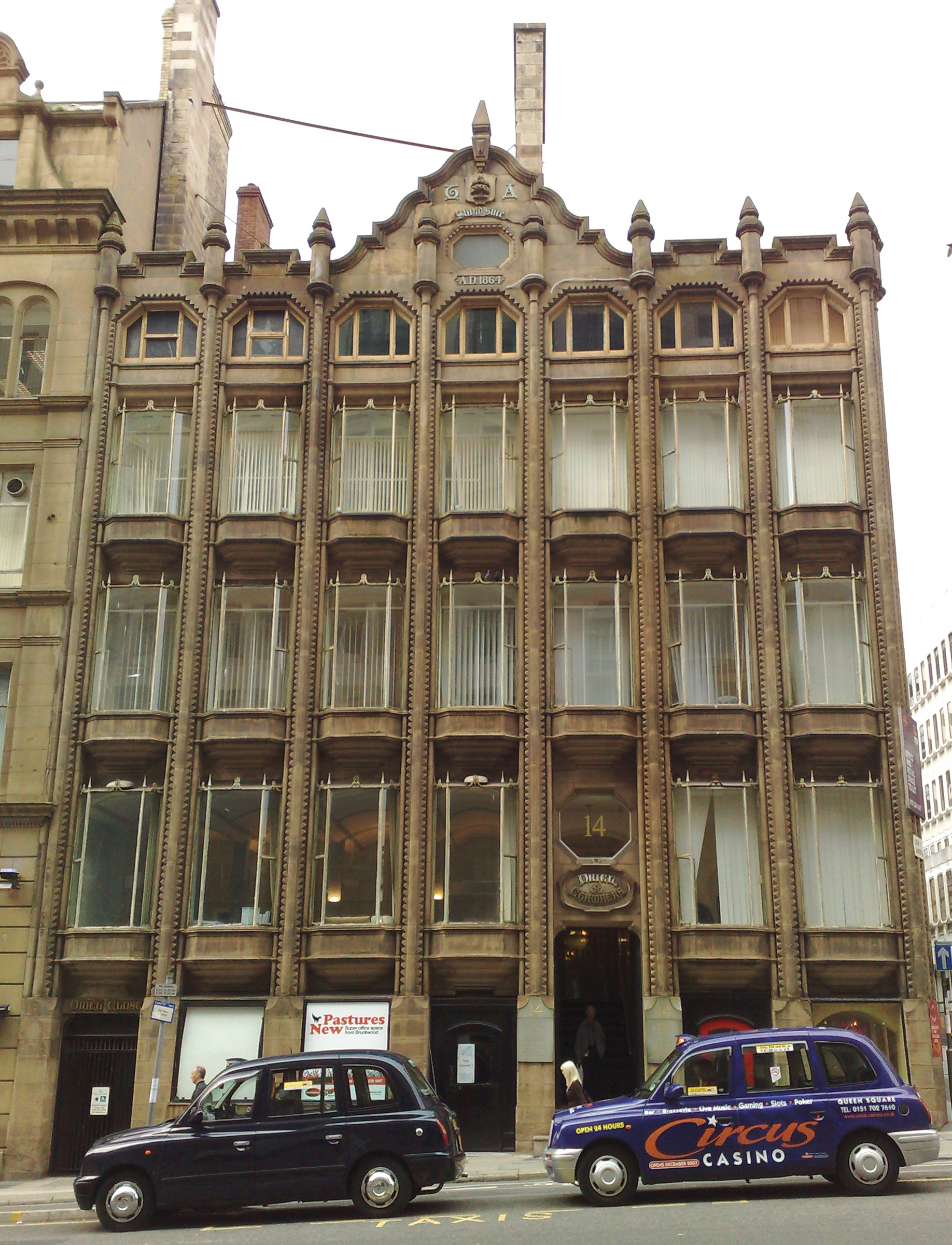 Oriel Chambers, Liverpool, England,1864. The world's first glass curtain walled building. The stone mullions are decorative.
