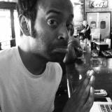 Paul Varghese sitting in diner, black and white.jpg