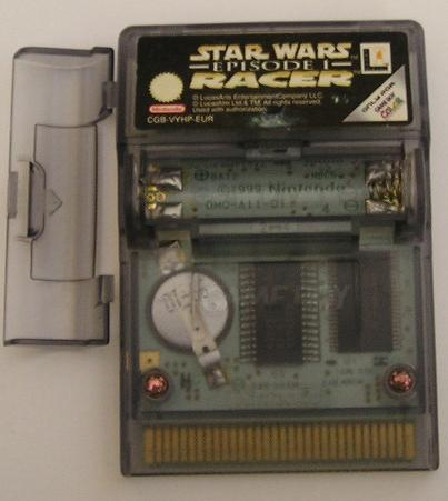 """""""Star Wars Episode I Racer"""" Game Boy Color cartridge. Front view with open batery slot. The specially-designed cartridge. Contains a replacable battery"""